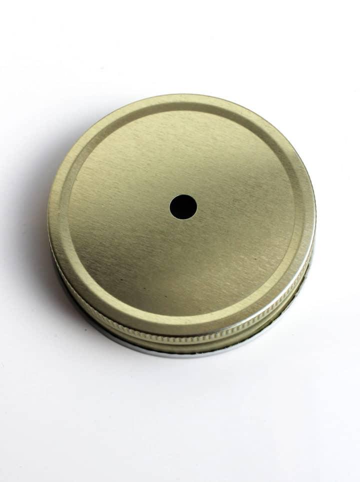 Goldener Decke mit Loch für Mason Jar